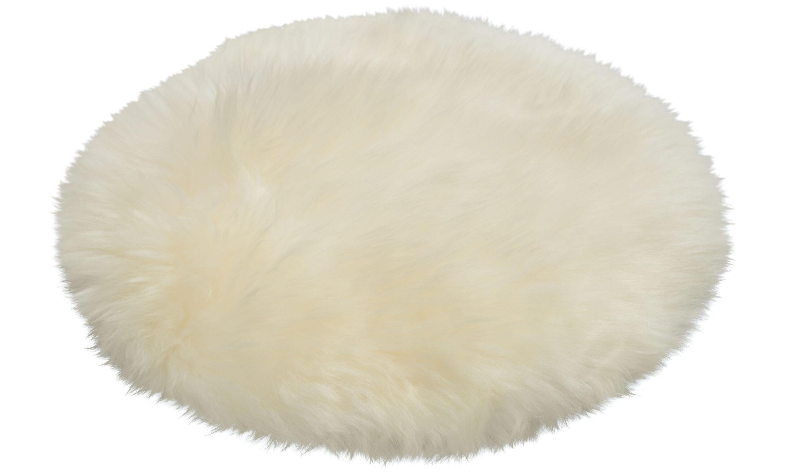 Langhåret rund stolpute i lammeskinn - hvit